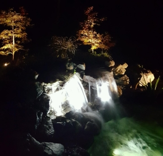 Lighted waterfall at night